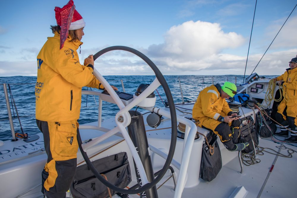 Leg 3, Cape Town to Melbourne, day 16, on board Turn the Tide on Plastic. Francesca watching videos of her faily wishing her a erry christmas while Liz is driving to Melbourne. Photo by Jeremie Lecaudey/Volvo Ocean Race. 24 December, 2017.